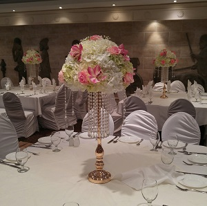 Crystal garlands gold stands with florals centerpieces